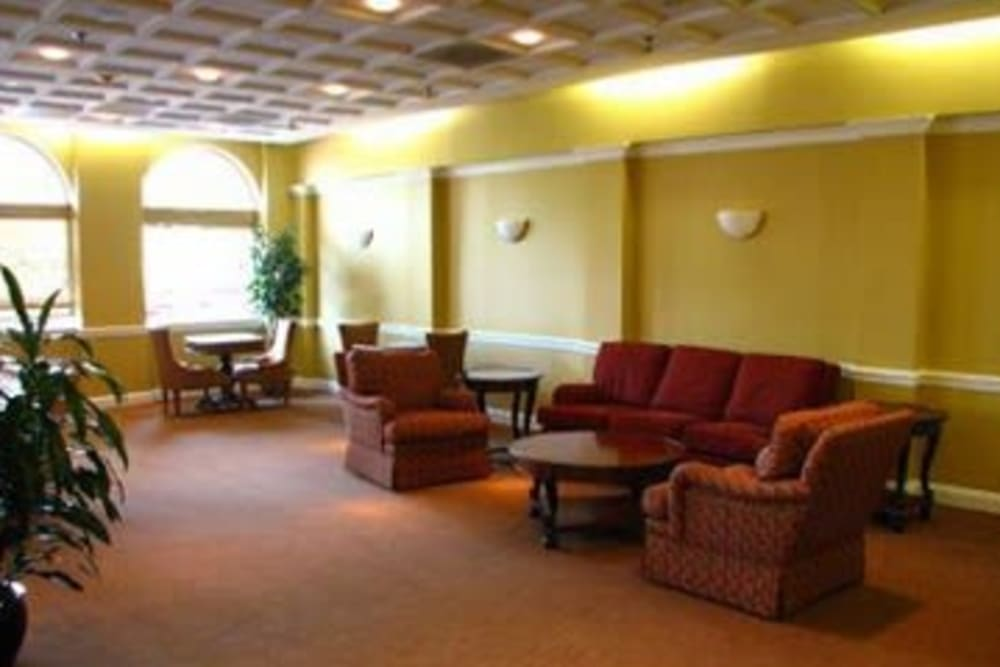A social room with comfortable couches at Westwood Tower Apartments in Bethesda, Maryland