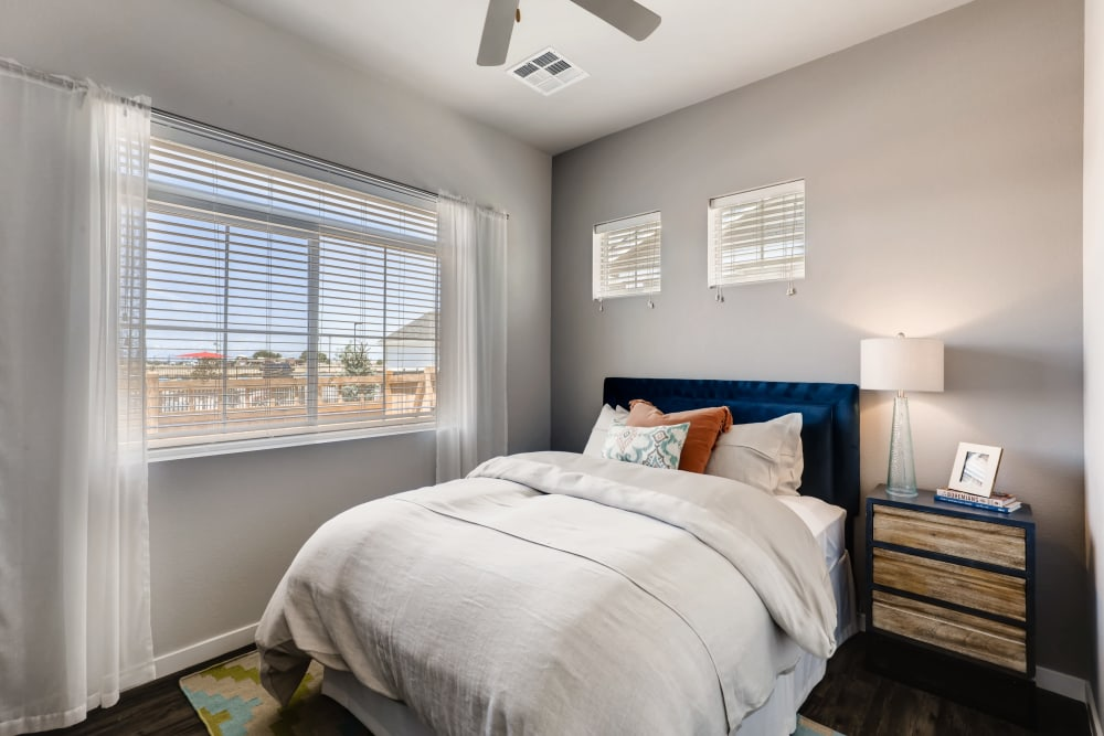 Sun-lit bedroom at Avilla Buffalo Run in Commerce City, Colorado