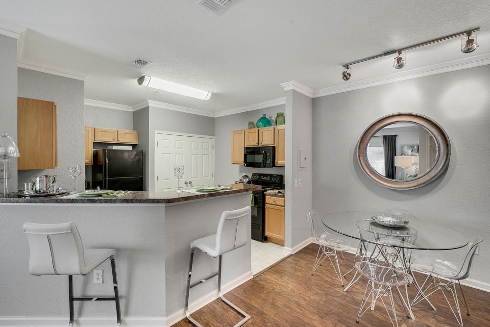 Kitchen bar with chairs in model apartment at Palms at World Gateway in Orlando, Florida