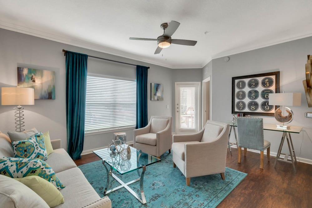 Living room with patio access at Palms at World Gateway in Orlando, Florida