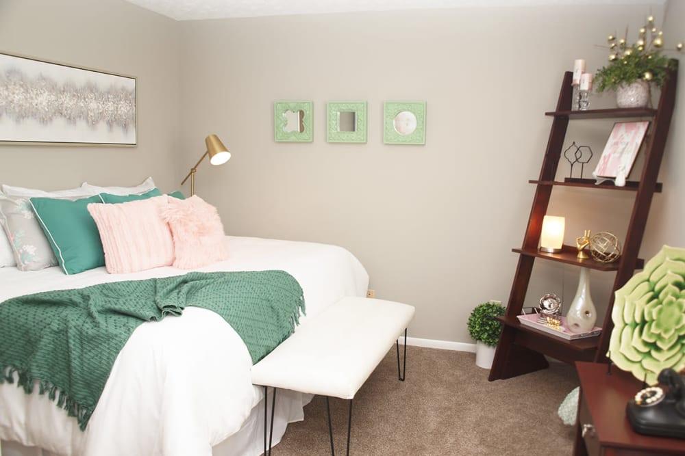 Comfortable bedroom at Fox Chase Apartments in Cincinnati, Ohio