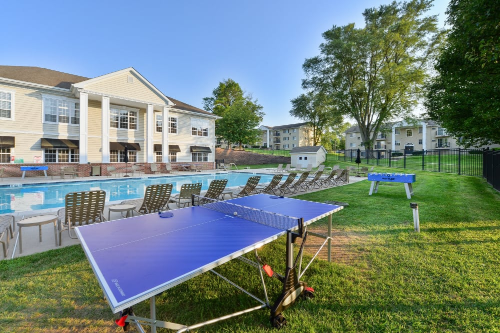 Swimming pool & outdoor ping pong table at Stonegate at Devon Apartments in Devon, Pennsylvania