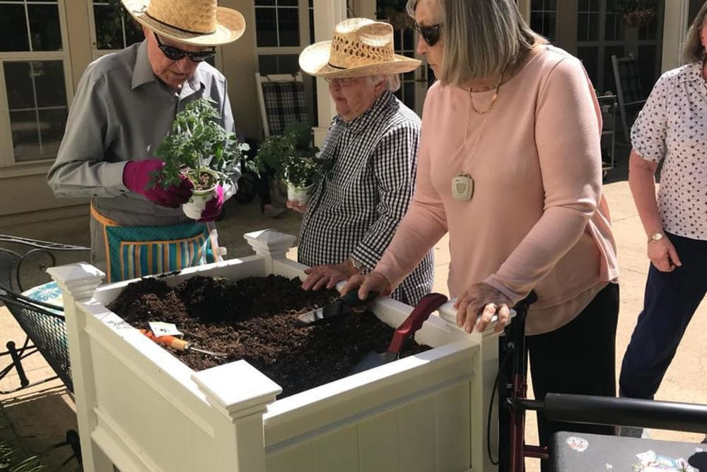 Residents gardening at Parsons House Preston Hollow in Dallas, Texas