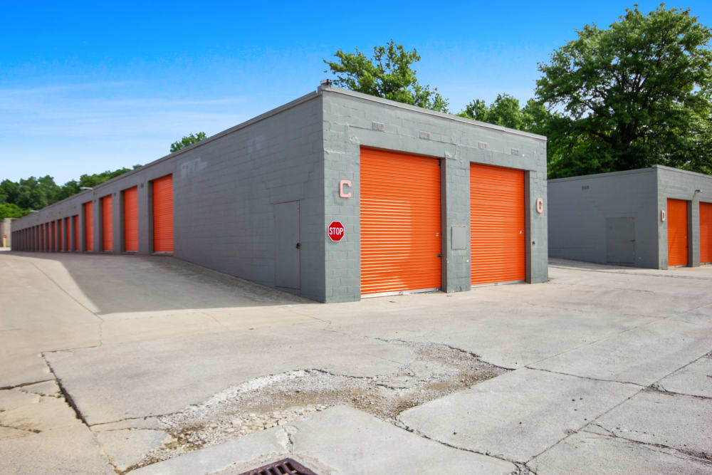 Outdoor storage units with orange doors at Global Self Storage in Lima, Ohio