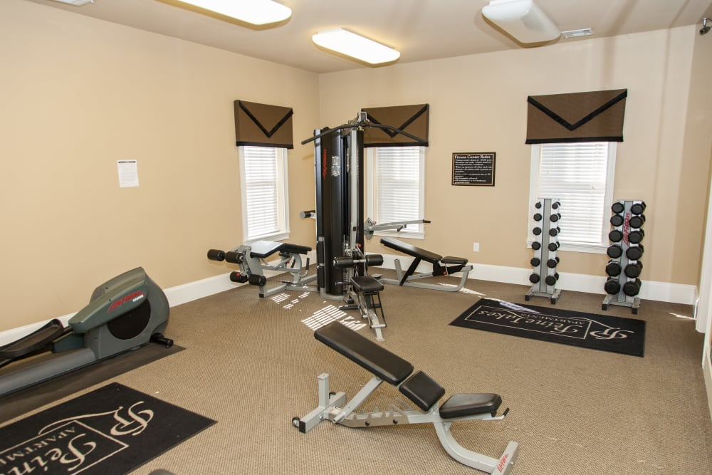 A fitness center with individual workout stations at Peine Lakes in Wentzville, Missouri