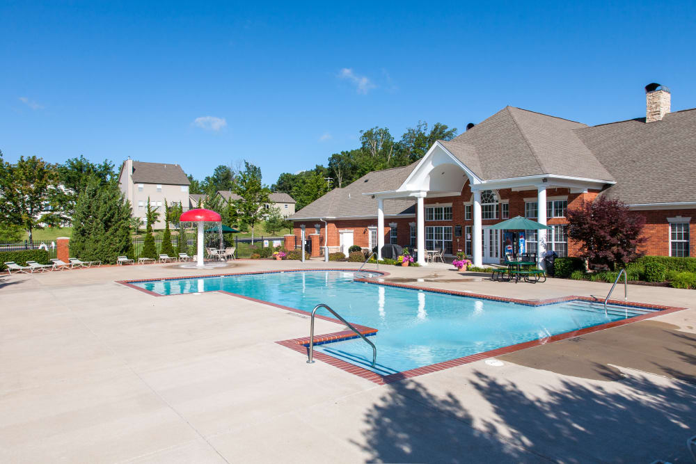 A swimming pool with a large sundeck at Peine Lakes in Wentzville, Missouri