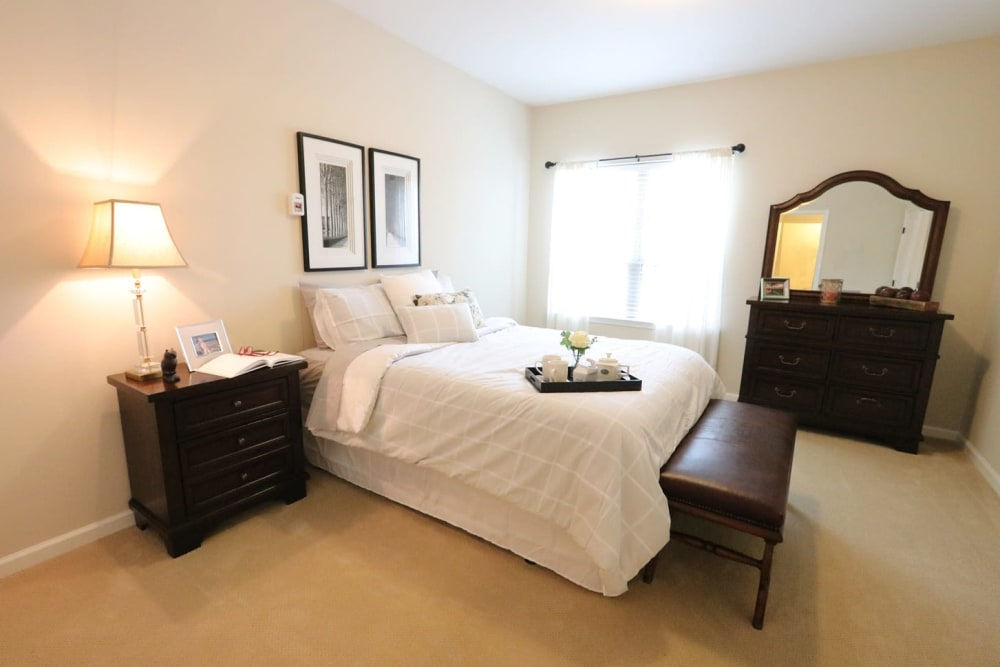 A spacious, decorated bedroom at Harmony at Savannah in Savannah, Georgia