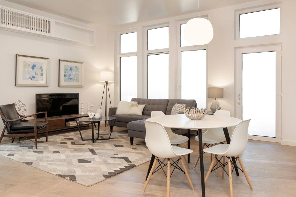Hardwood floors and floor-to-ceiling windows in a model home at TwentyTwenty Apartments in Portland, Oregon