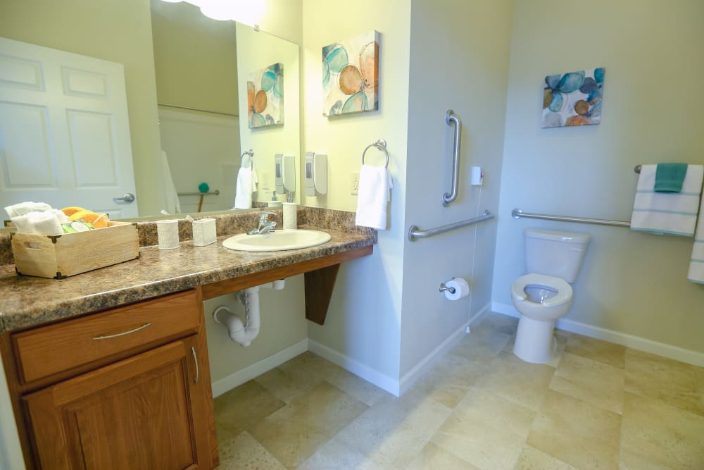 An apartment bathroom attached to the bedroom at Harmony at Chantilly in Herndon, Virginia