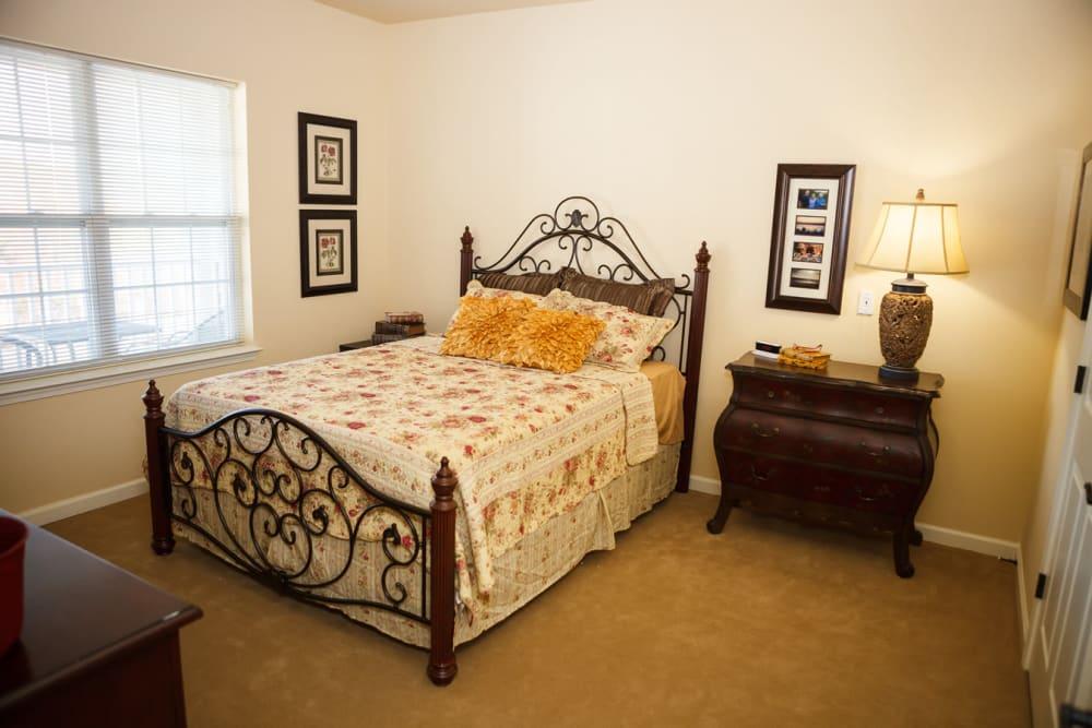 A spacious, furnished bedroom at Harmony at Falls Run in Fredericksburg, Virginia