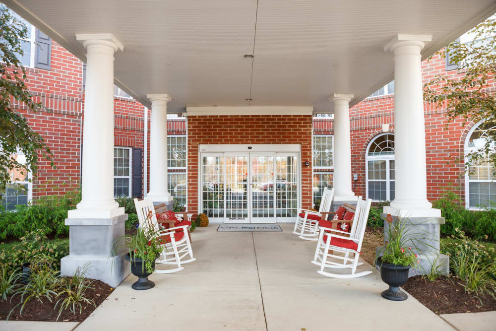 Covered outdoor seating on the porch at Harmony at Falls Run in Fredericksburg, Virginia