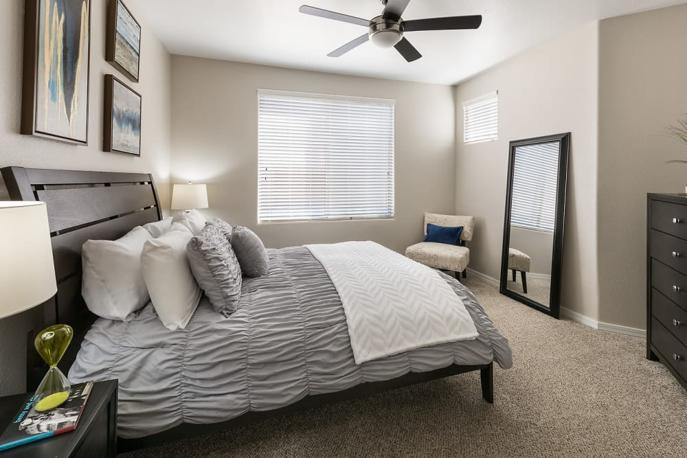 Large bedroom with ceiling fan at Laguna at Arrowhead Ranch in Glendale, Arizona