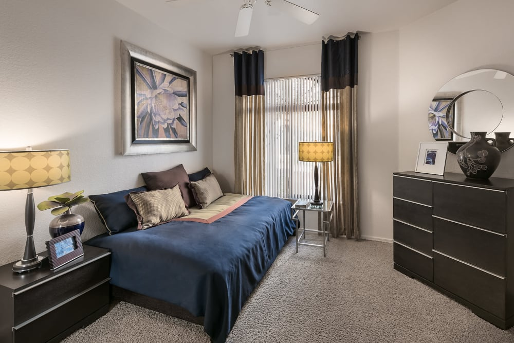 Large master bedroom with a ceiling fan and beautiful furnishings in a model home at San Pedregal in Phoenix, Arizona