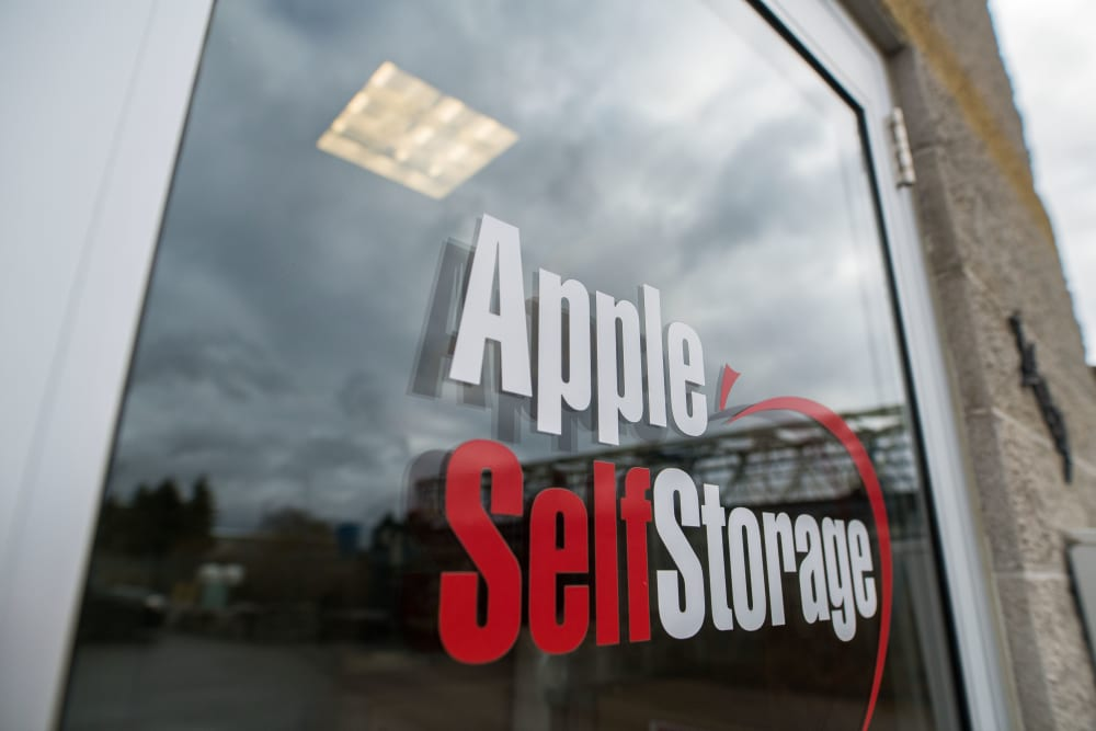 Logo on front door at Apple Self Storage - Aurora in Aurora, Ontario