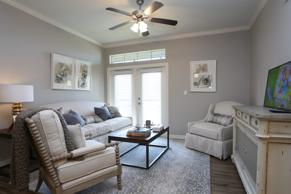 Living room with a ceiling fan at Acadia Villas in Thibodaux, Louisiana
