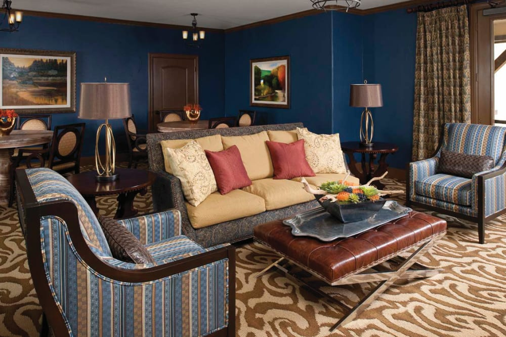A sitting area with a couch and two chairs at Isle at Cedar Ridge in Cedar Park, Texas