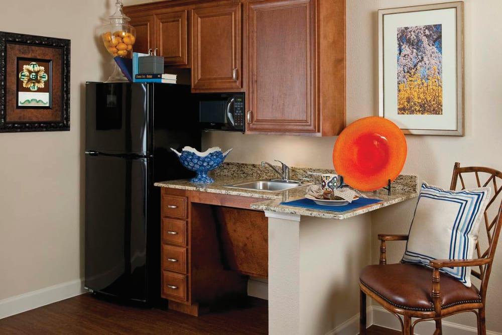 A furnished kitchen at Isle at Cedar Ridge in Cedar Park, Texas