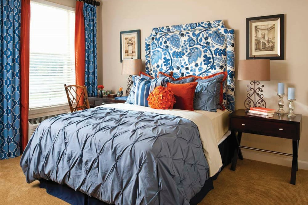 A large bed in a bedroom at Isle at Cedar Ridge in Cedar Park, Texas