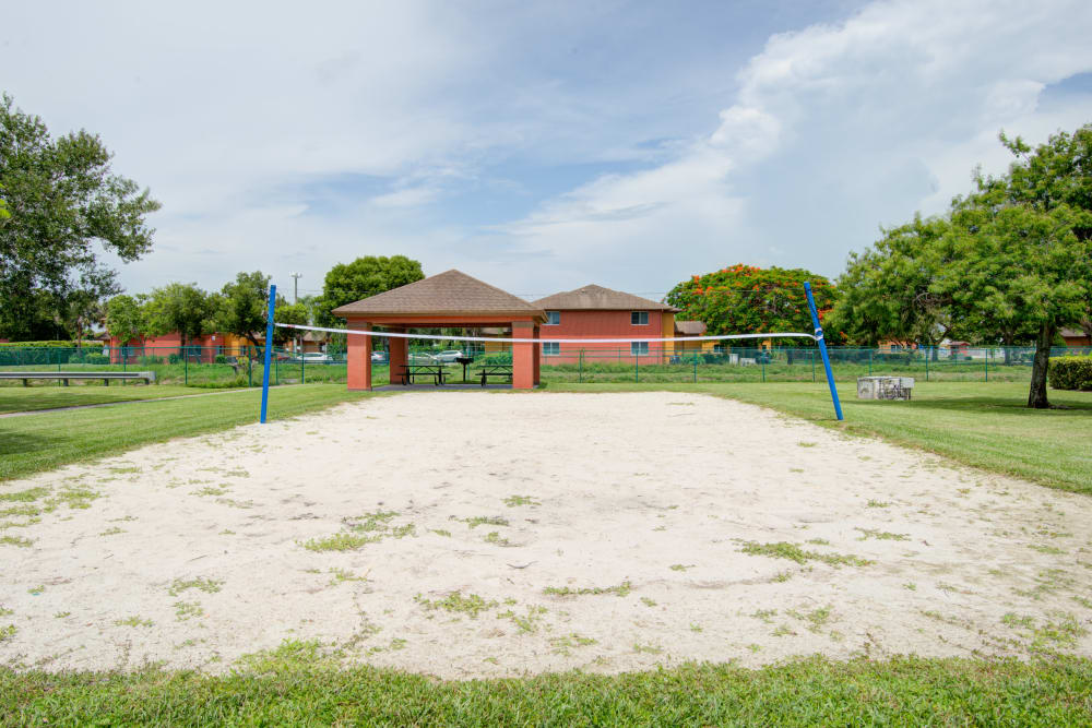 A beautiful outdoor volleyball court at Running Brook Apartments in Miami, Florida