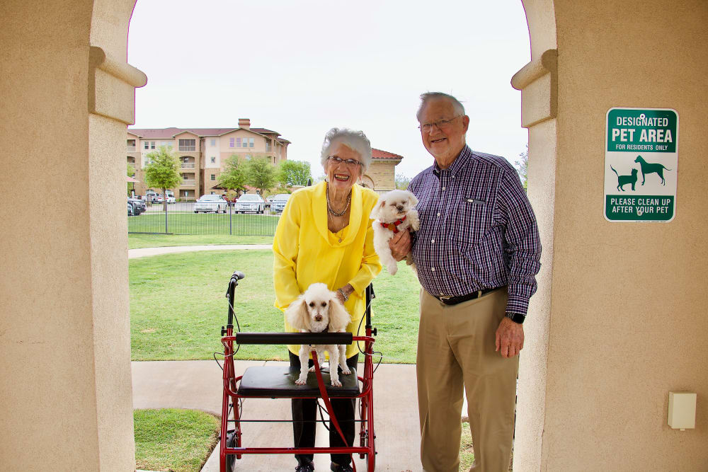 A couple with their dog at Isle at Raider Ranch in Lubbock, Texas