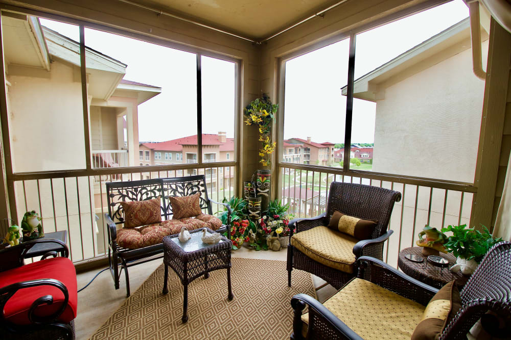 A room with large windows and plenty of seating at Isle at Raider Ranch in Lubbock, Texas