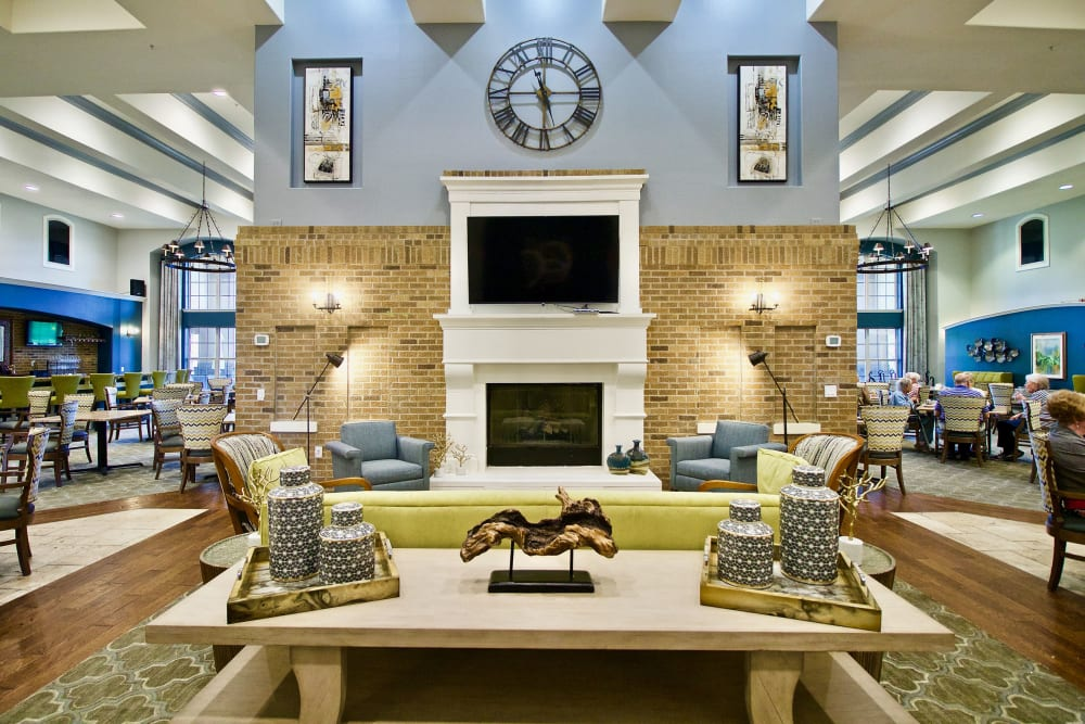 A decorated room with television at Isle at Raider Ranch in Lubbock, Texas