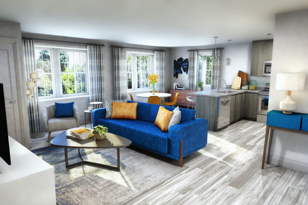 Living room model with blue accents at Reserve Pointe Apartments in Canandaigua, New York