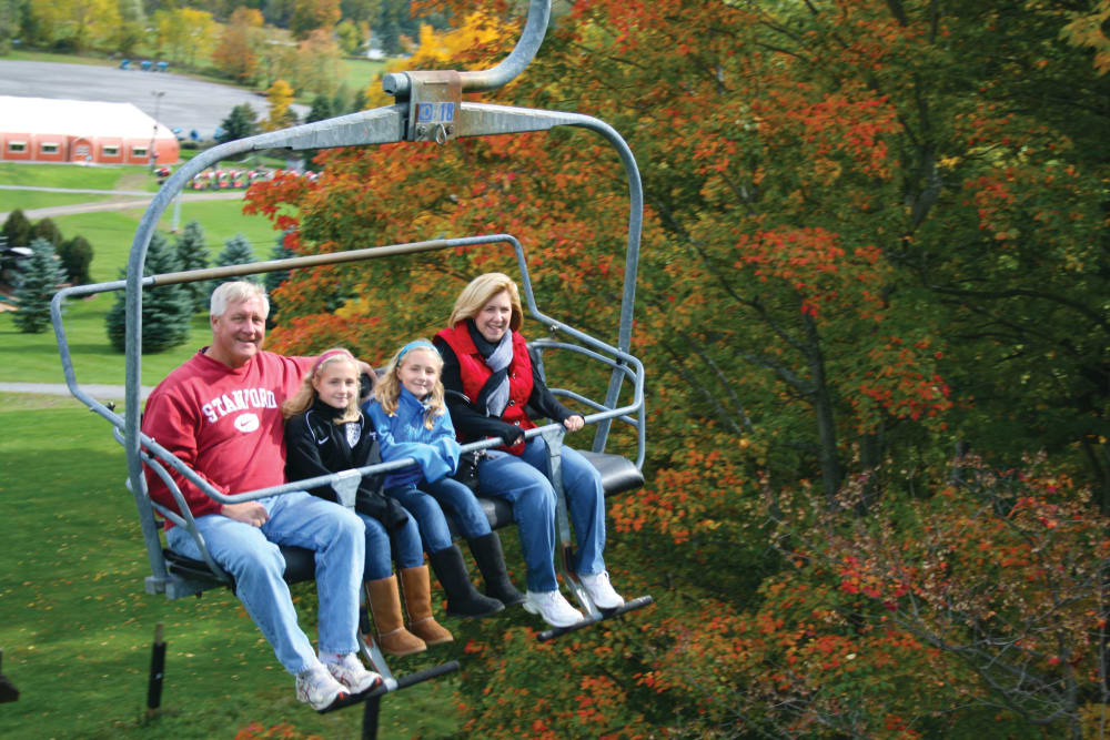 Happy family on a chairlift near Reserve Pointe Apartments in Canandaigua, New York