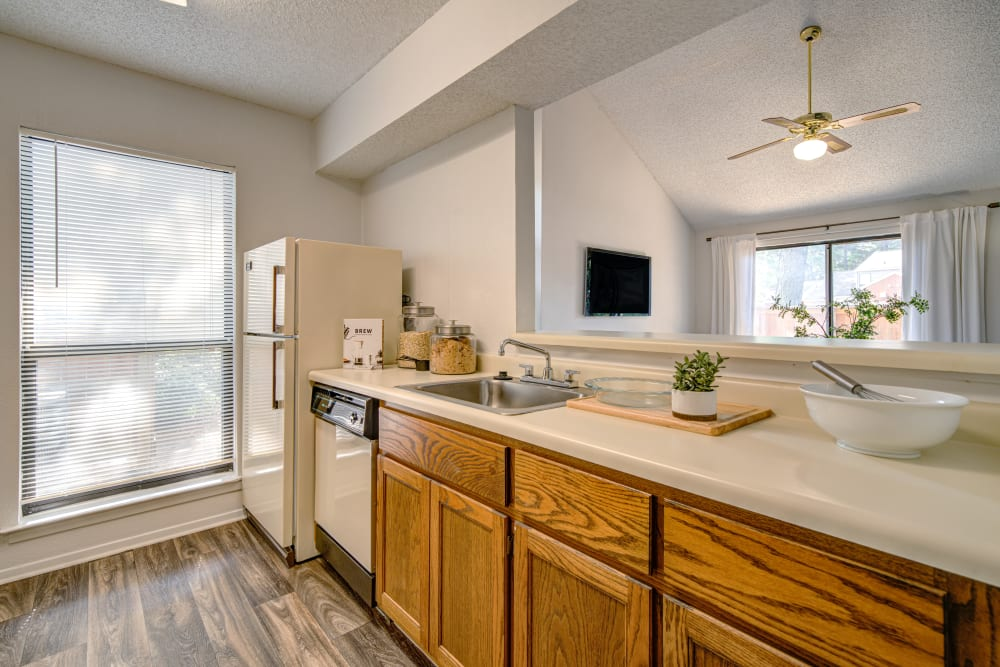 A kitchen with a pass-through window at Waterview Apartment Homes in Memphis, Tennessee