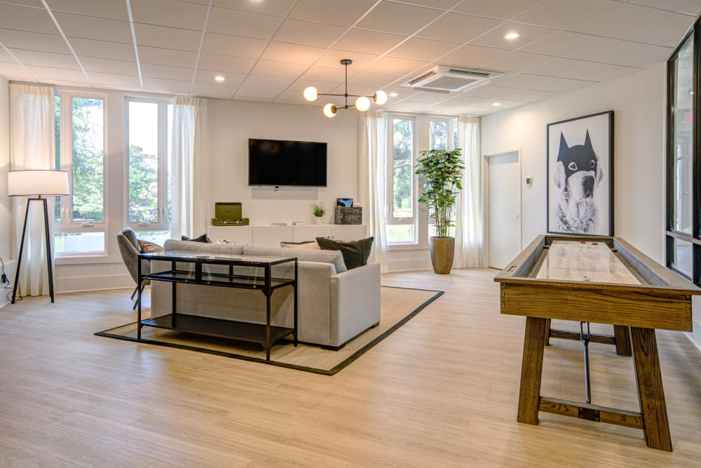 A clubhouse with a shuffle board and a flat-screen TV at Waterview Apartment Homes in Memphis, Tennessee