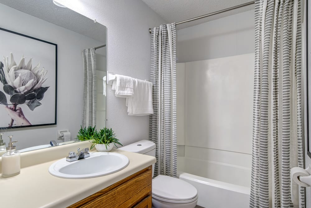 A bathroom with an oval tub at Waterview Apartment Homes in Memphis, Tennessee