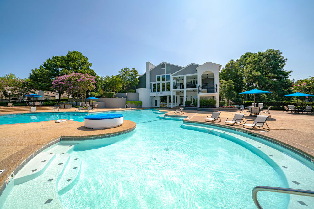 A luxury pool with a large sundeck at Waterview Apartment Homes in Memphis, Tennessee