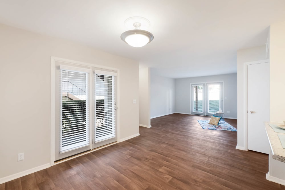 Hardwood floor with large open windowed doors leading to patio at Riverside North