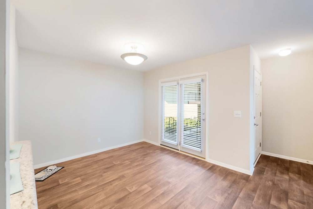 Well lit room with hardwood floors at Riverside North