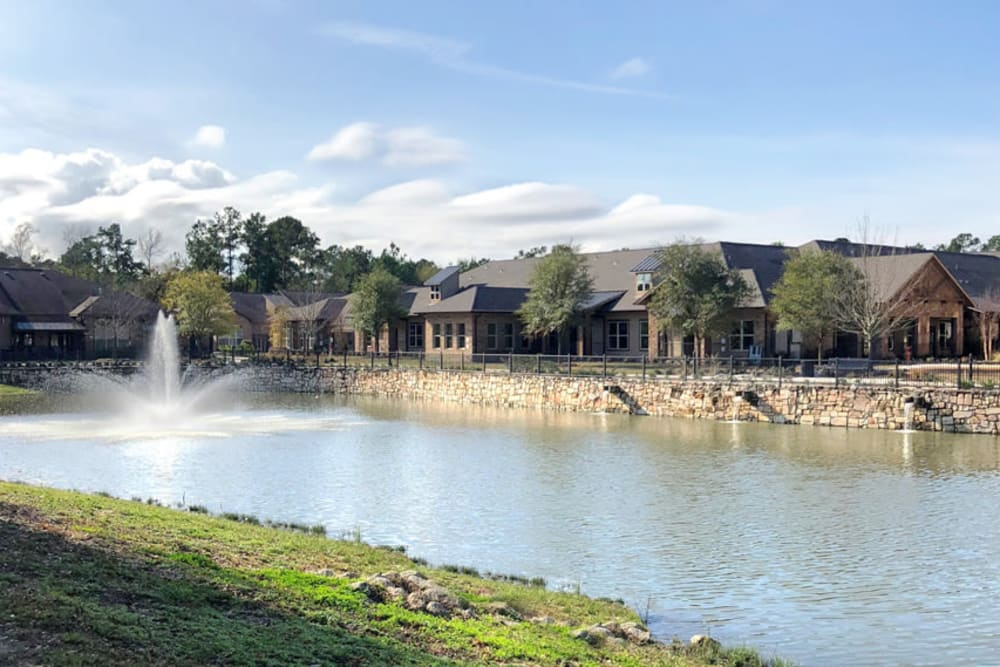 A view of the fountain and pond in front of Watercrest at Kingwood in Kingwood, Texas