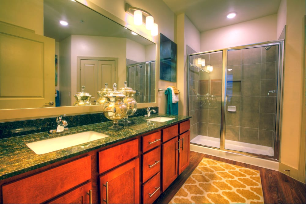 A large bathroom with shower and sink at Watercrest at Kingwood in Kingwood, Texas
