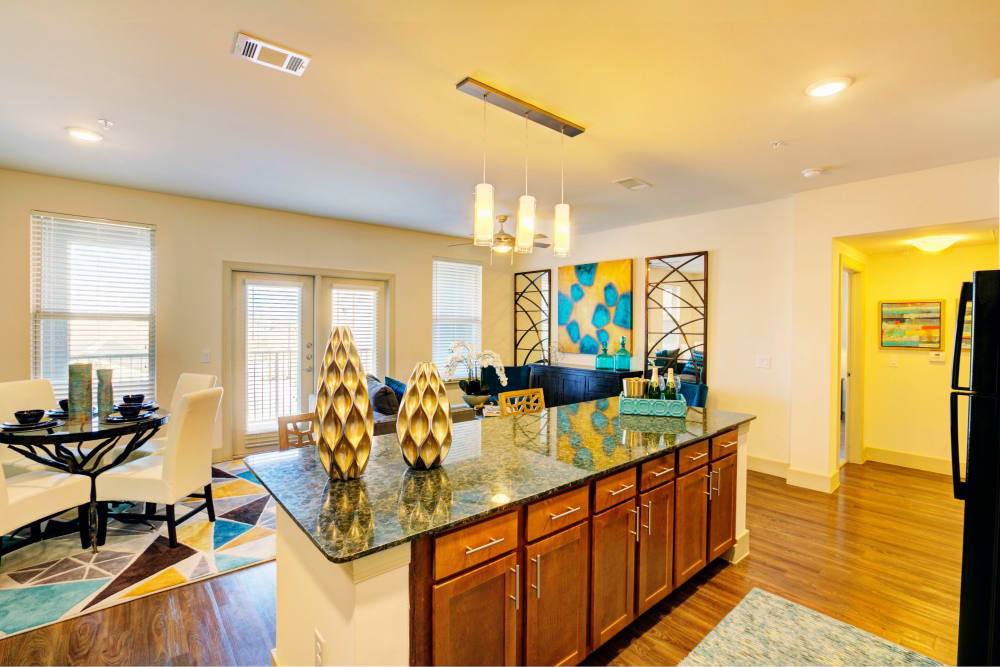 A kitchen with an island with decorations at Watercrest at Kingwood in Kingwood, Texas