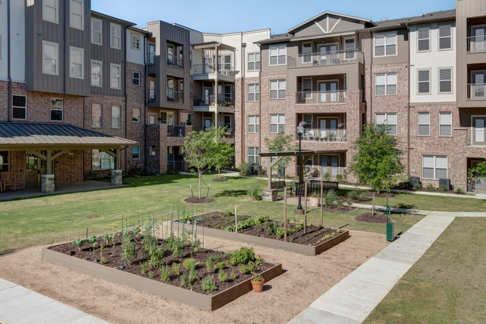 A couple of garden beds in front of Watercrest at Katy in Katy, Texas