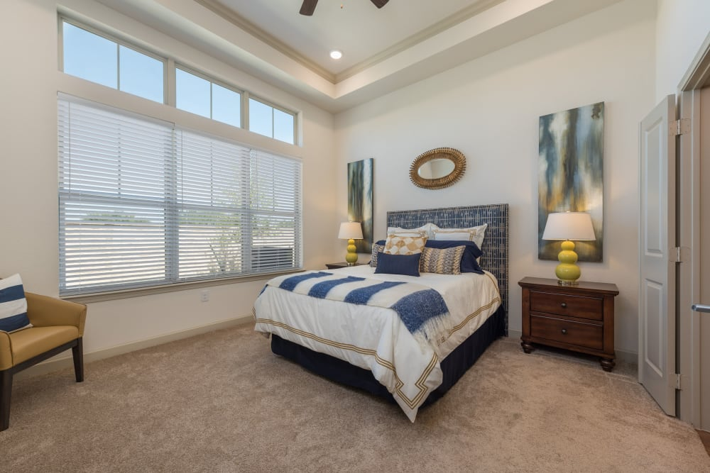 A fully furnished bedroom at Watercrest at Katy in Katy, Texas