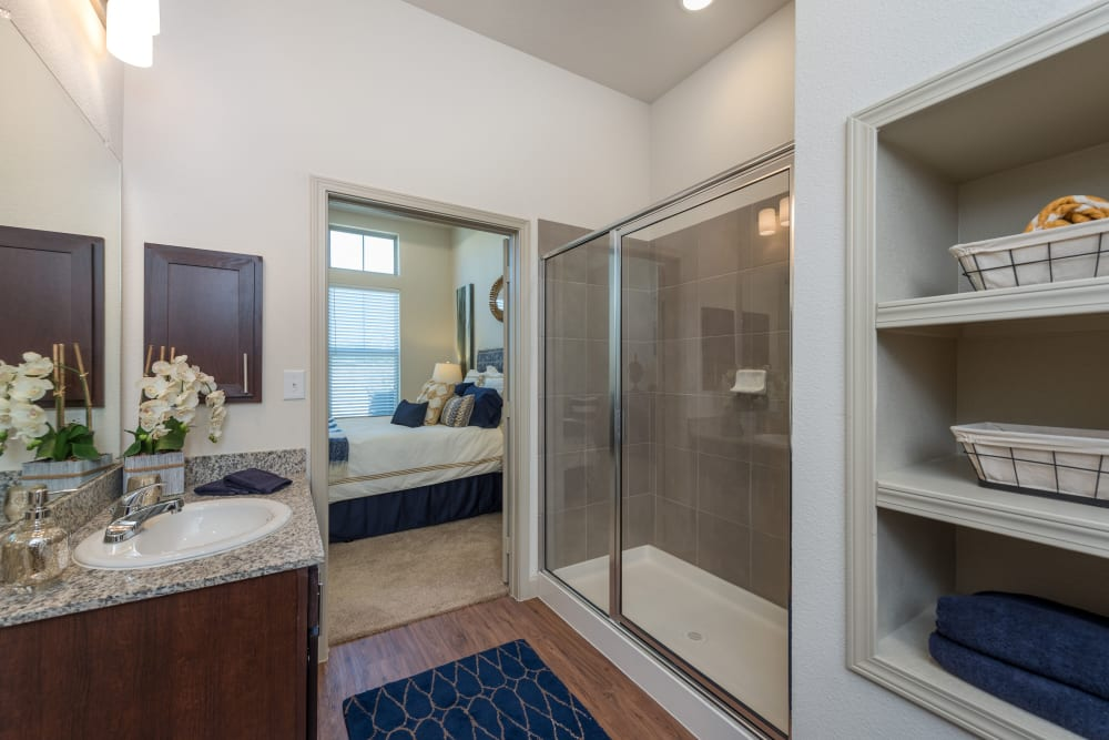 The bathroom in an apartment at Watercrest at Katy in Katy, Texas