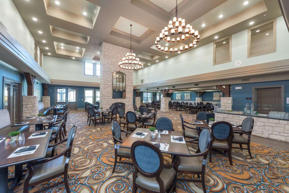 Dining tables in a large room at Watercrest at Katy in Katy, Texas