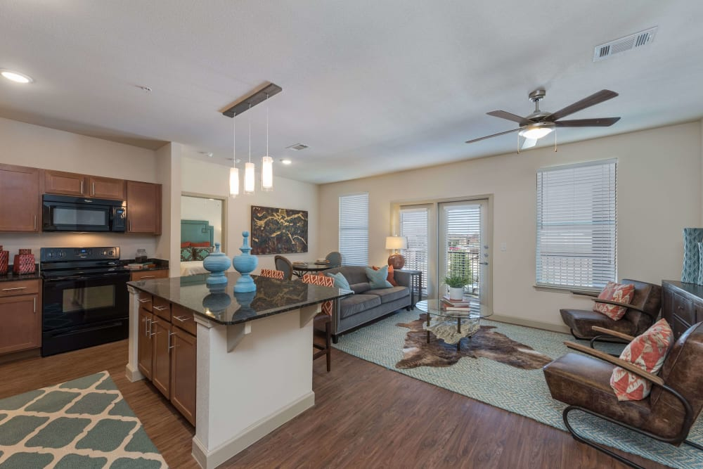 A kitchen and living room space, decorated at Watercrest at Katy in Katy, Texas