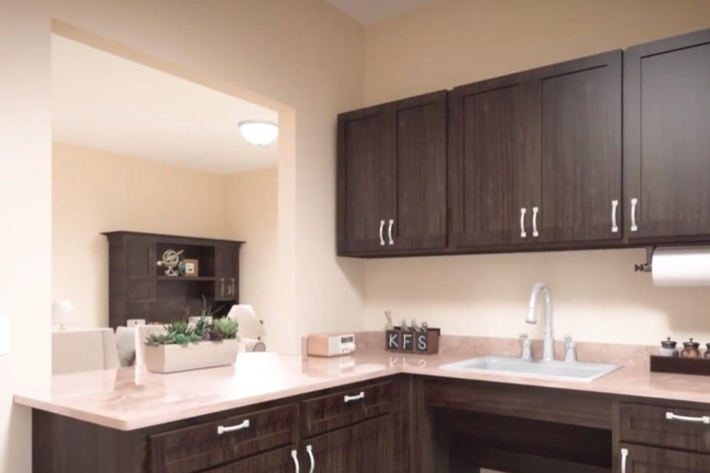 A rendering of counter tops in an apartment kitchen at Harmony at Hope Mills in Fayetteville, North Carolina