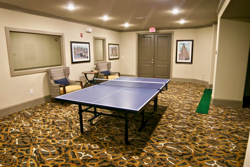 A room with a table tennis table and putting green at Watercrest at Shadow Creek Ranch in Pearland, Texas