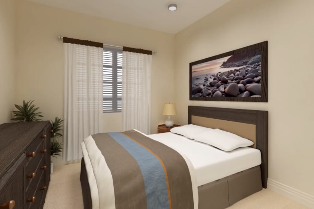 An apartment bedroom with furniture at Harmony at Greensboro in Greensboro, North Carolina