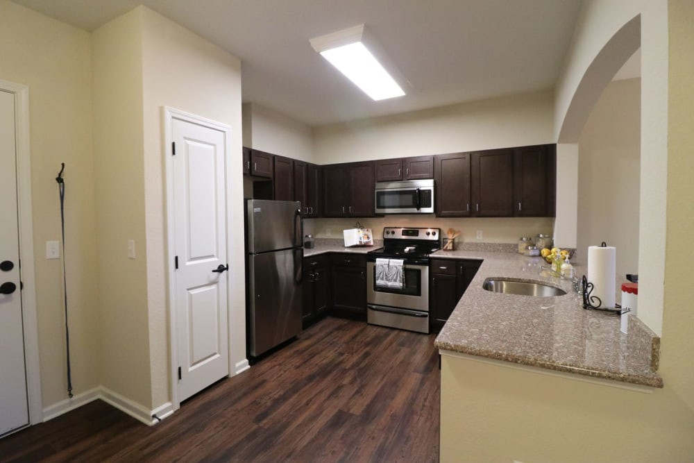 An apartment kitchen with stainless steel appliances at Harmony at Five Forks in Simpsonville, South Carolina