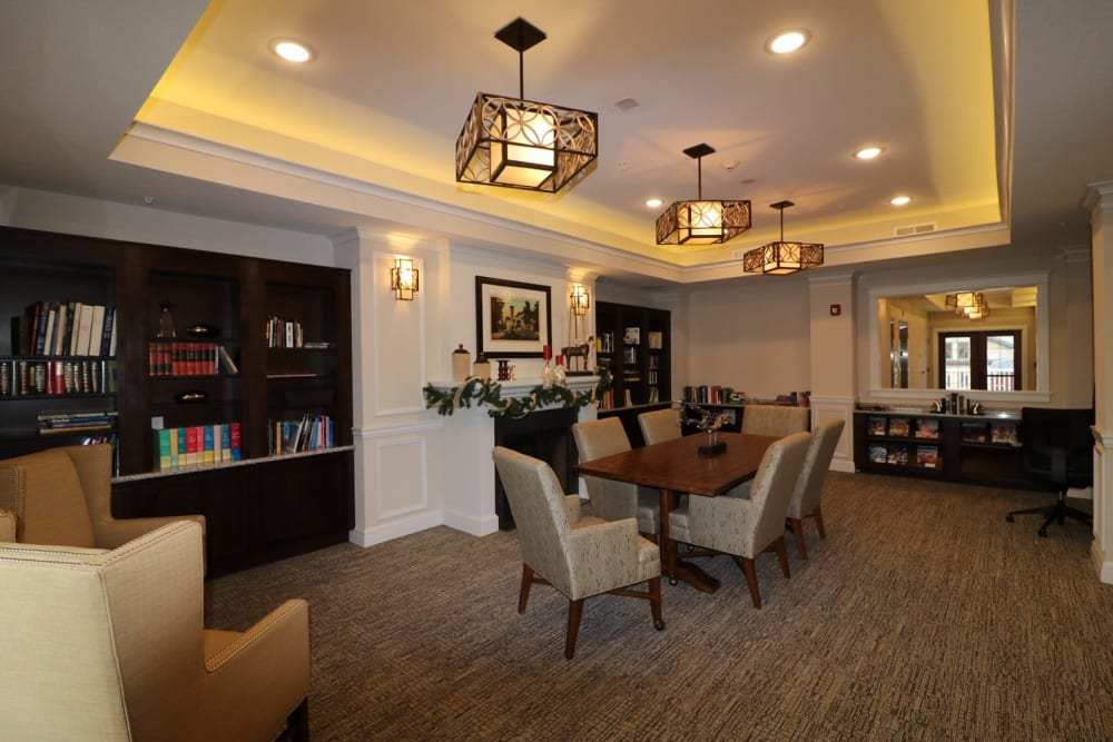Comfortable seating in the library at Harmony at Five Forks in Simpsonville, South Carolina