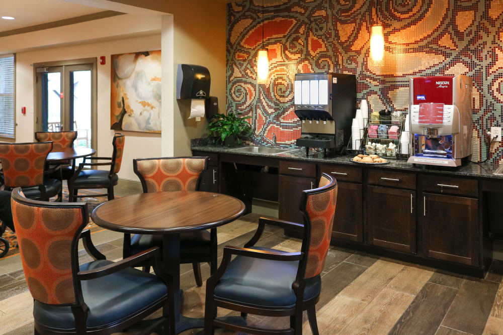 A small dining area with coffee and juice machine at Landing at Watercrest Shadow Creek Ranch in Pearland, Texas
