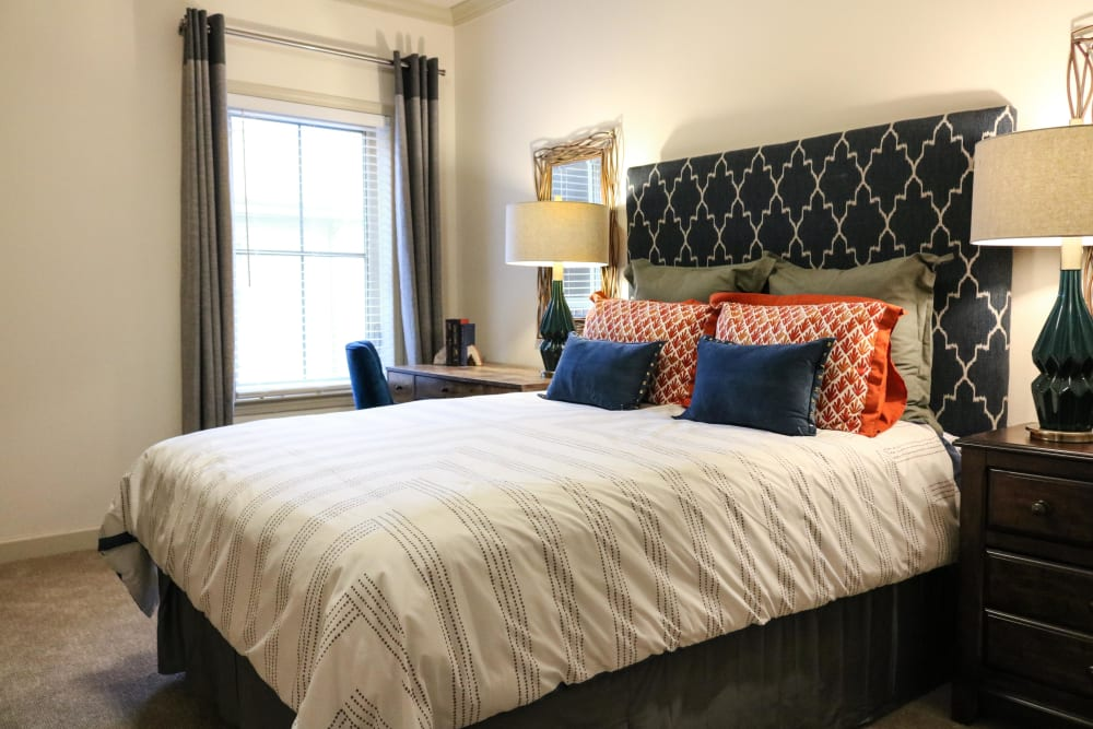 A large comfy bed at Landing at Watercrest Shadow Creek Ranch in Pearland, Texas