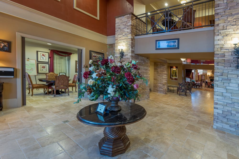 The lobby area with flower bouquet at Watercrest at Bryan in Bryan, Texas